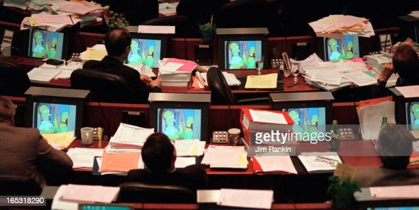 TORONTO 10/10/00 Toronto councillors watch a Simpson's television episode on their monitors during a controversial vote at city hall on shipping the...
