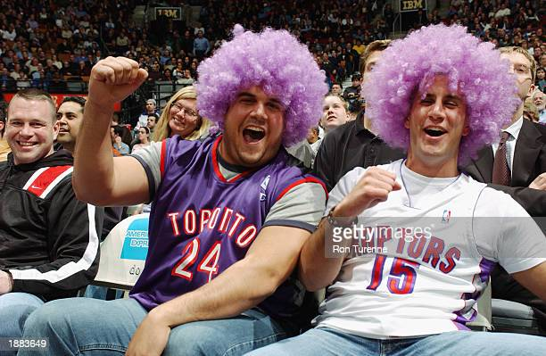 Toronto fans cheer during the NBA game between the Atlanta Hawks and the Toronto Raptors at Air Canada Centre on March 19 2003 in Toronto Canada The...
