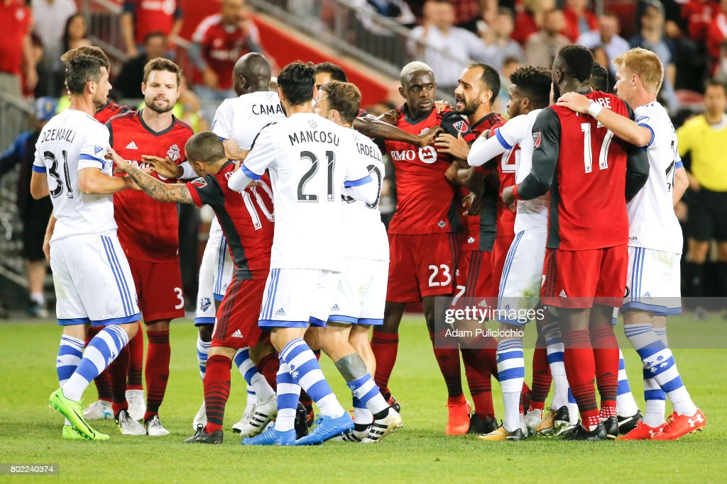 Toronto FC and Montreal Impact players push and shove late in the 2nd half during Leg 2 of the 2017 Canadian Championship. Toronto FC would go on to win the match 2 - 1 and win the Canadian Championship 3 -2 on aggregate on June 27, 2017 at BMO Field in Toronto, Canada.