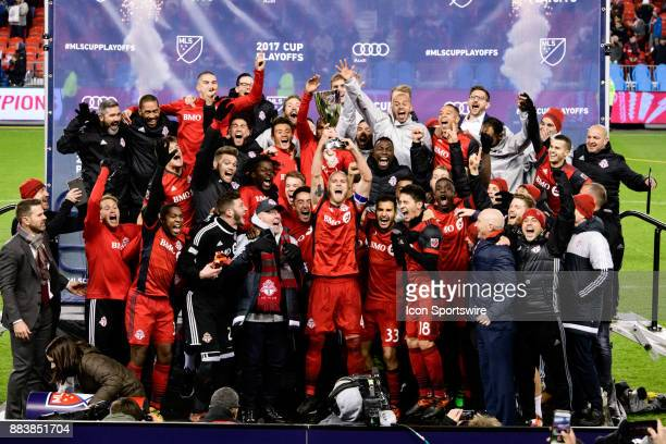 Toronto FC captain Michael Bradley lifts the MLS Eastern Conference trophy while the rest of the team celebrates after the second leg of the MLS Cup...
