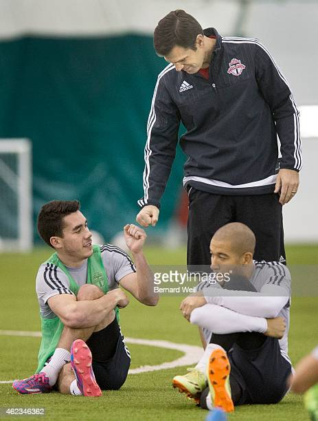 Toronto FC coach Greg Vanney fist pumps midfielder Daniel Lovitz during the first Toronto FC training camp at Kia Training Grounds Downsview Park