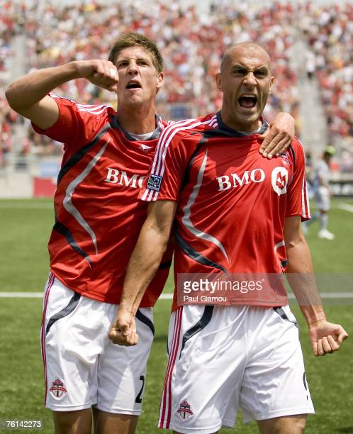 Toronto FC defender Andrew Boyens and forward Danny Dichio in celebration of the second goal of the match during the game against FC Dallas at BMO...