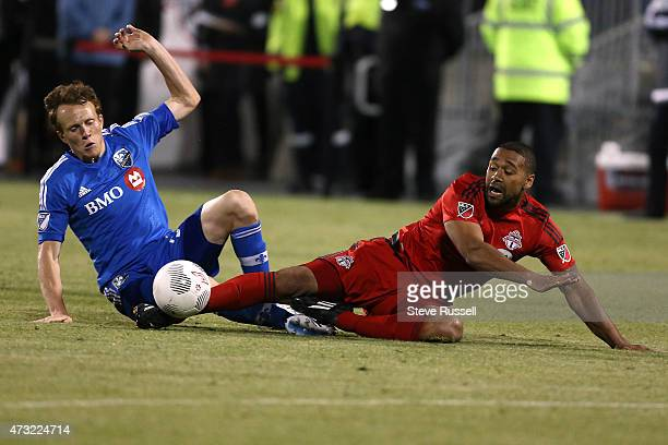 TORONTO ON MAY 13 Toronto FC defender Ashtone Morgan is taken down by Montreal Impact defender Wandrille Lefevre as Toronto FC beats the Montreal...