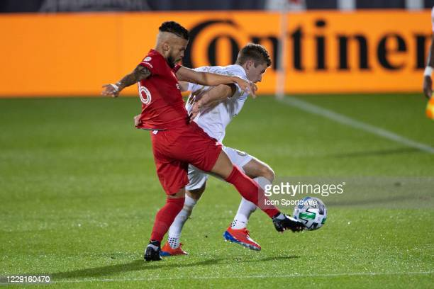 Toronto FC Defender Auro Jr and Atlanta United FC Forward Jon Gallagher battle for the ball during the first half of a Major League Soccer match...