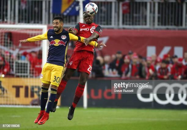 TORONTO ON NOVEMBER 5 Toronto FC defender Chris Mavinga heads the ball with New York Red Bulls midfielder Gonzalo Veron as Toronto FC play the New...