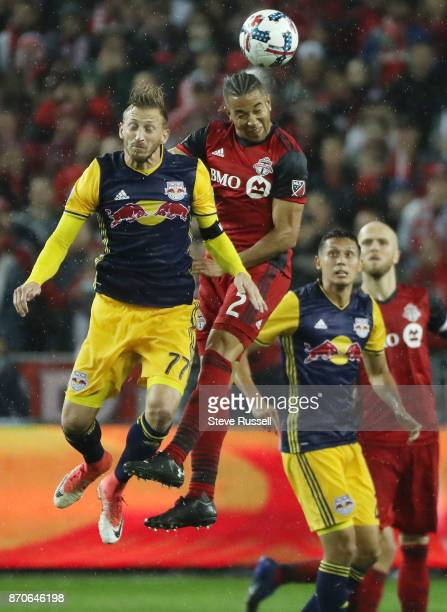 TORONTO ON NOVEMBER 5 Toronto FC defender Justin Morrow gets higher than New York Red Bulls midfielder Daniel Royer for a header as Toronto FC play...