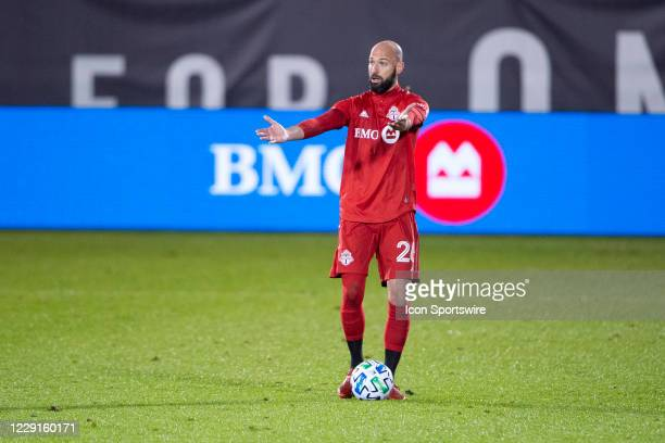 Toronto FC Defender Laurent Ciman controls the ball and motions to his teammates during the second half of a Major League Soccer match between the...