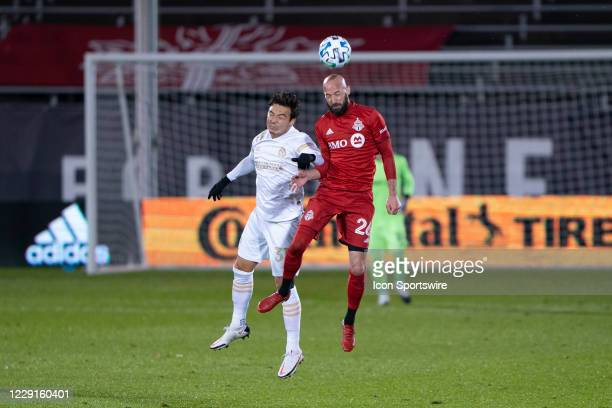 Toronto FC Defender Laurent Ciman heads the ball with Atlanta United FC Forward Erick Torres during the second half of a Major League Soccer match...