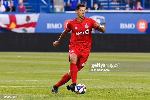Toronto FC defender Omar Gonzalez runs in control of the ball during the Toronto FC versus the Montreal Impact game on July 13 at Stade Saputo in...