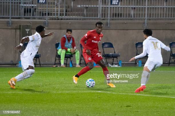 Toronto FC Defender Richie Laryea dribbles the ball between Atlanta United FC Defender George Bello and Atlanta United FC Midfielder Marcelino Moreno...