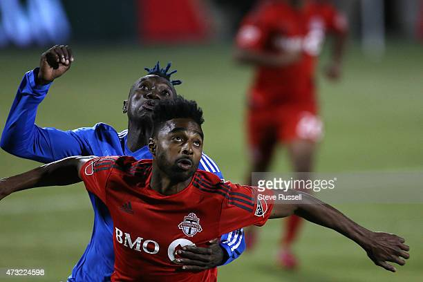 TORONTO ON MAY 13 Toronto FC defender Warren Creavalle and Montreal Impact forward Dominic Oduro battle for the ball as Toronto FC beats the Montreal...