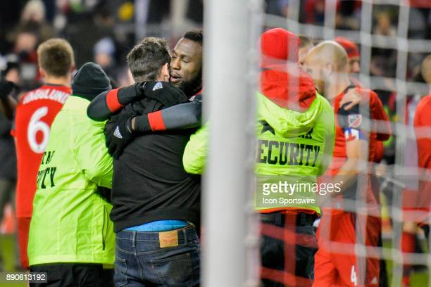 Toronto FC fan who ran onto the field and was apprehended by security is hugged after being approached in gratitude as a fan by Toronto FC Forward...