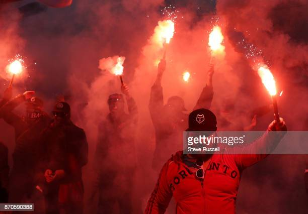 TORONTO ON NOVEMBER 5 Toronto FC fans gather in Liberty Village and march to the stadium chanting and lighting flares on the route as Toronto FC play...