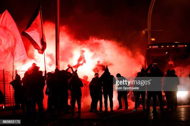 Toronto FC fans light torches to welcome the Toronto FC team bus before the second leg of the MLS Cup eastern conference final between Toronto FC and...