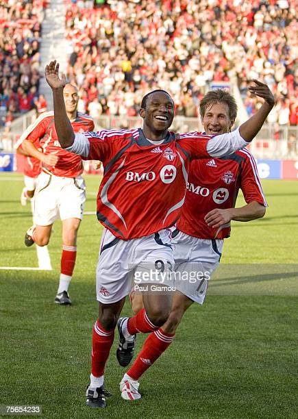 Toronto FC first goal of the match is celebrated by scorer Jeff Cunningham during their match against the New York Red Bulls in Toronto, Ontario,...