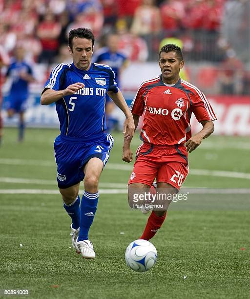 Toronto FC forward Amado Guevara chases the ball with Kansas City Wizards midfielder Kerry Zavagnin during their game on April 26 2008 at BMO Field...