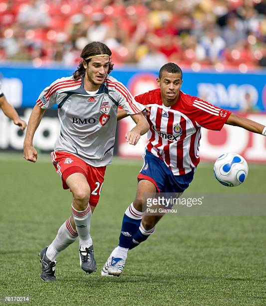 Toronto FC forward Andrea Lombardo fights for the ball with Chivas USA defender Jason Hernandez during the match between Chivas USA and Toronto FC at...
