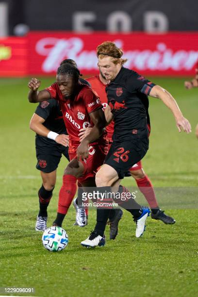 Toronto FC Forward Ayo Akinola and New York Red Bulls Defender Tim Parker battle for the ball during the second half of a Major League Soccer match...