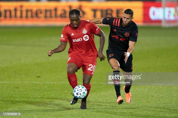 Toronto FC Forward Ayo Akinola dribbles the ball with New York Red Bulls Defender Amro Tarek defending during the first half of a Major League Soccer...