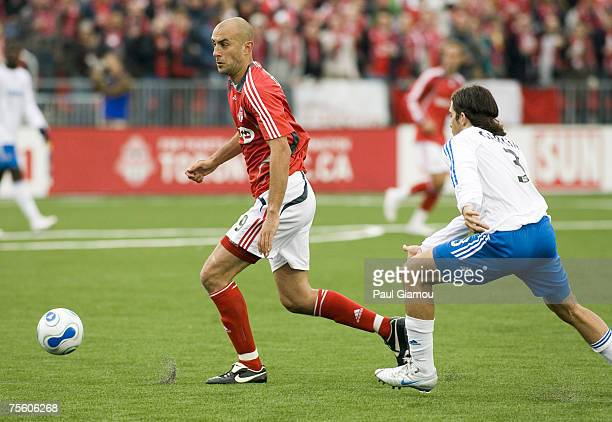 Toronto FC forward Danny Dichio chases the ball with Kansas City Wizards defender Nick Garcia in pursuit during the home opening match against the...