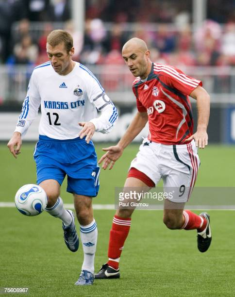 Toronto FC forward Danny Dichio chases the ball with Kansas City Wizards defender Jimmy Conrad during the home opening match against the Kansas City...