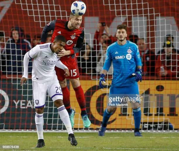 Toronto FC forward Eriq Zavaleta gets to the ball ahead of Orlando City forward Stefano Pinho in front of Toronto FC goalkeeper Alex Bono Toronto FC...