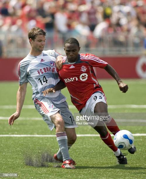 Toronto FC forward Jeff Cunningham controls the ball as Drew Moor challenges during the match against FC Dallas at BMO Field in Toronto Canada on...