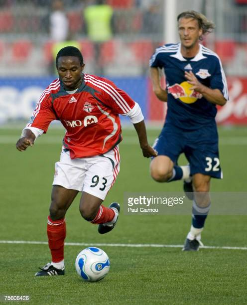 Toronto FC forward jeff Cunningham controls the ball as midfielder Markus Schopp gives chase during the match against the New York Red Bulls in...
