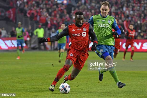 Toronto FC Forward Jose Altidore fight for the ball with Seattle Sounders Defender Chad Marshall during the MLS CUP Finals between the Seattle...