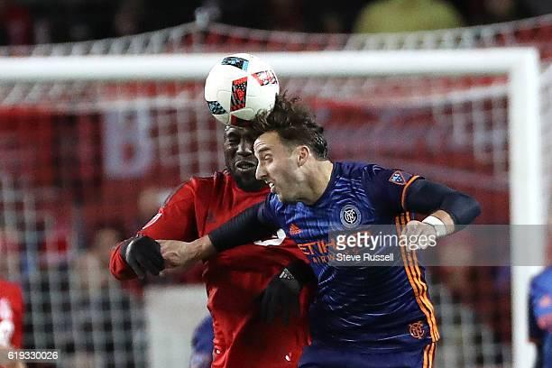 TORONTO ON OCTOBER 30 Toronto FC forward Jozy Altidore and New York City FC defender RJ Allen go after the ball as Toronto FC beat New York City FC...