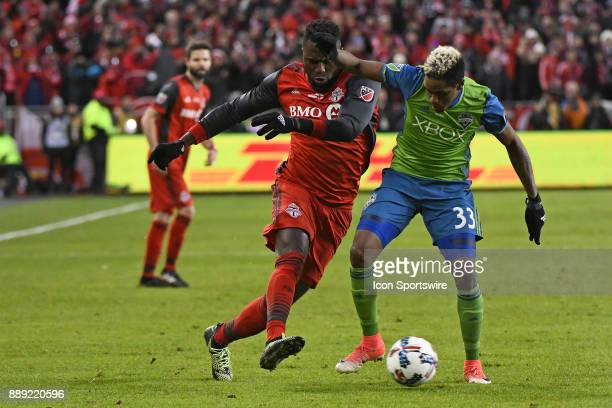 Toronto FC Forward Jozy Altidore and Seattle Sounders Midfielder Joevin Jones fight for the ball during the MLS CUP Finals between the Seattle...