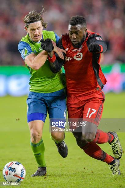 Toronto FC Forward Jozy Altidore is tackled by Seattle Sounders Gustev Svensson during the first half of the MLS Cup Final played between the Seattle...