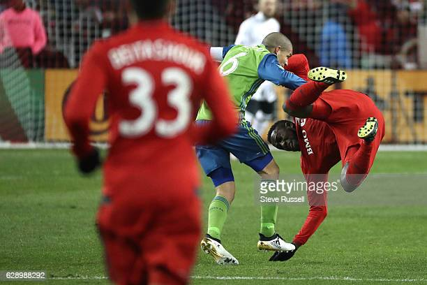 TORONTO ON DECEMBER 10 Toronto FC forward Jozy Altidore is tripped up by Seattle Sounders midfielder Osvaldo Alonso Toronto FC plays Seattle Sounders...