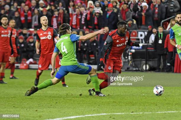 Toronto FC Forward Jozy Altidore moves the ball past Seattle Sounders Defender Gustav Svensson during the MLS CUP Finals between the Seattle Sounders...