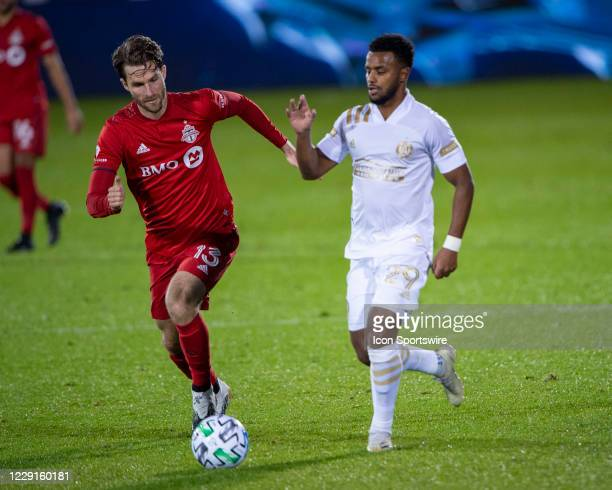 Toronto FC Forward Patrick Mullins and Atlanta United FC Midfielder Mo Adams battle for the ball during the second half of a Major League Soccer...