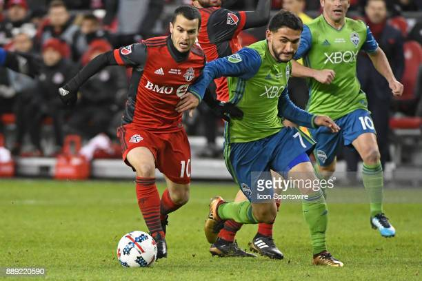 Toronto FC Forward Sebastian Giovinco and Seattle Sounders Midfielder Cristian Roldan fight for the ball during the MLS CUP Finals between the...