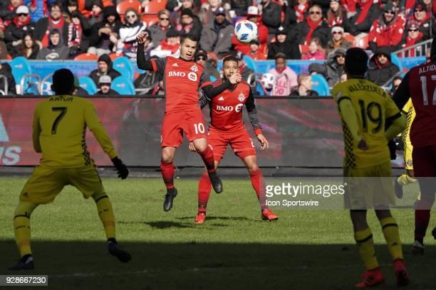 Toronto FC Forward Sebastian Giovinco and teammate Defender Justin Morrow handle the ball on a play during the MLS regular season Toronto FC...