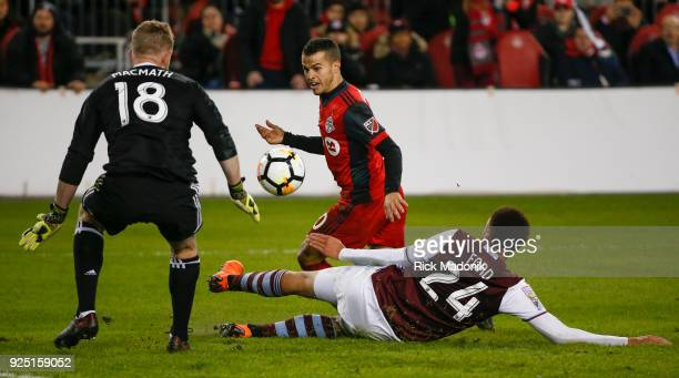 Toronto FC forward Sebastian Giovinco can't find the ball as Colorado Rapids defender Kortne Ford makes a nice defensive play in front of Colorado...