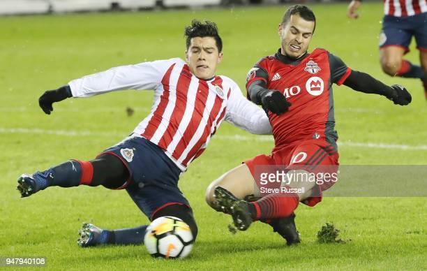 TORONTO ON APRIL 17 Toronto FC forward Sebastian Giovinco gets off a shot before Chivas de Guadalajara midfielder Michael Perez can get to him as the...