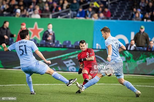 Toronto FC Forward Sebastian Giovinco kicks the ball through NYCFC defenders Andoni Iraola and Frederic Brillant during the Soccer 2016 Major League...