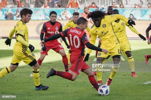 Toronto FC Forward Sebastian Giovinco readies to kick the ball past Columbus Crew SC Defender Lalas Abubakar during the MLS regular season Toronto FC...