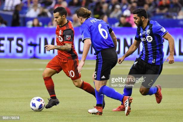 Toronto FC forward Sebastian Giovinco runs with the ball while chased by Montreal Impact midfielder Samuel Piette and Montreal Impact defender Victor...