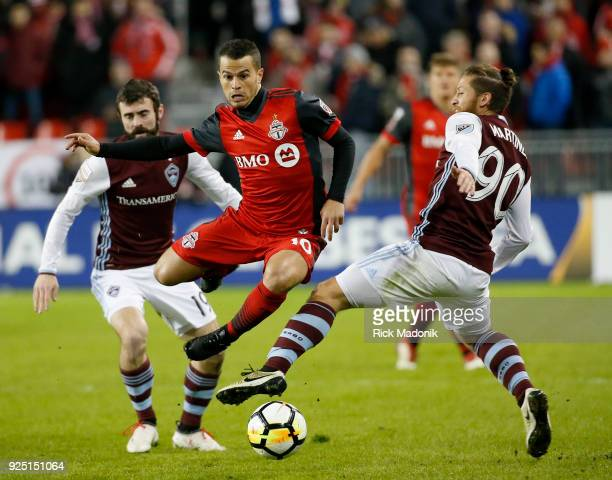Toronto FC forward Sebastian Giovinco splits the defence and eludes Colorado Rapids midfielder Enzo Martinez after escaping from Jack Price Toronto...