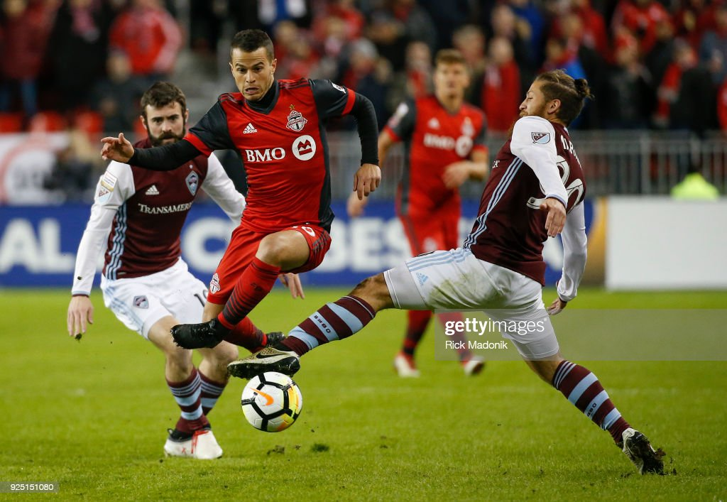 Toronto FC forward Sebastian Giovinco (10) splits the defence and eludes Colorado Rapids midfielder Enzo Martinez (90) after escaping from Jack Price (behind). Toronto FC vs Colorado Rapids in CONCACAF matchup during 1st half action in MLS regular season play at BMO Field. Toronto Star/Rick Madonik