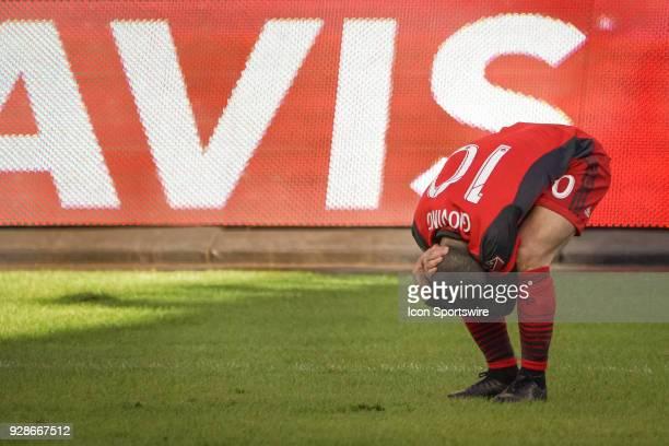 Toronto FC Forward Sebastian Giovinco takes a compact stance holding his head during the MLS regular season Toronto FC homeopener played vs the...