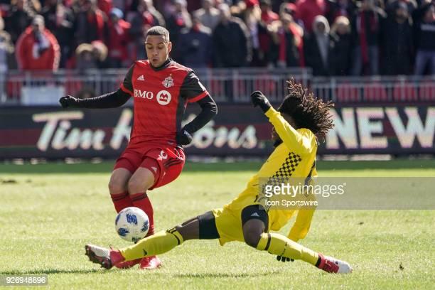 Toronto FC Forward Tsubasa Endoh gets the ball past Columbus Crew SC Defender Lalas Abubakar during the MLS regular season Toronto FC homeopener...