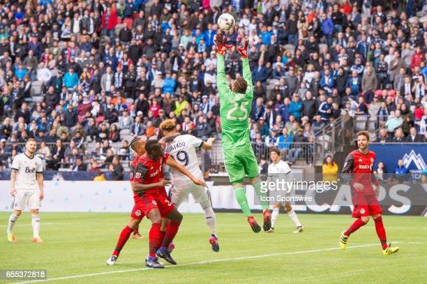 Toronto FC goalkeeper Alex Bono jumps to grab the ball during their match against the Vancouver Whitecaps at BC Place on March 18 2017 in Vancouver...