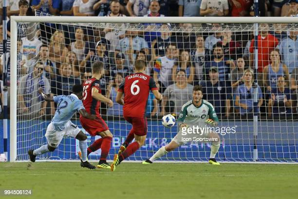 Toronto FC goalkeeper Alex Bono prepares to make a save on a shot by Sporting Kansas City forward Gerso in the second half of an MLS match between...