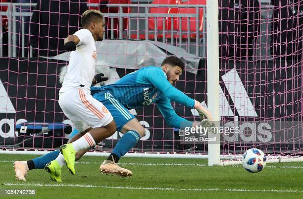 TORONTO ON OCTOBER 28 Toronto FC goalkeeper Alex Bono races to ball before Atlanta United forward Josef Martinez as Toronto FC play Atlanta United in...