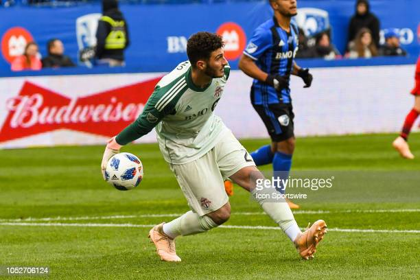 Toronto FC goalkeeper Alex Bono sends the ball back into play during the Toronto FC versus the Montreal Impact game on October 21 at Stade Saputo in...